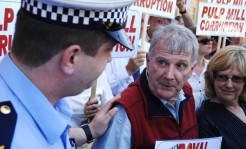 Peter Cundall is arrested outside Parliament House during anti-pulp mill protests in Hobart, Tasmania, 19 November 2009. Paul Carter, AAP.