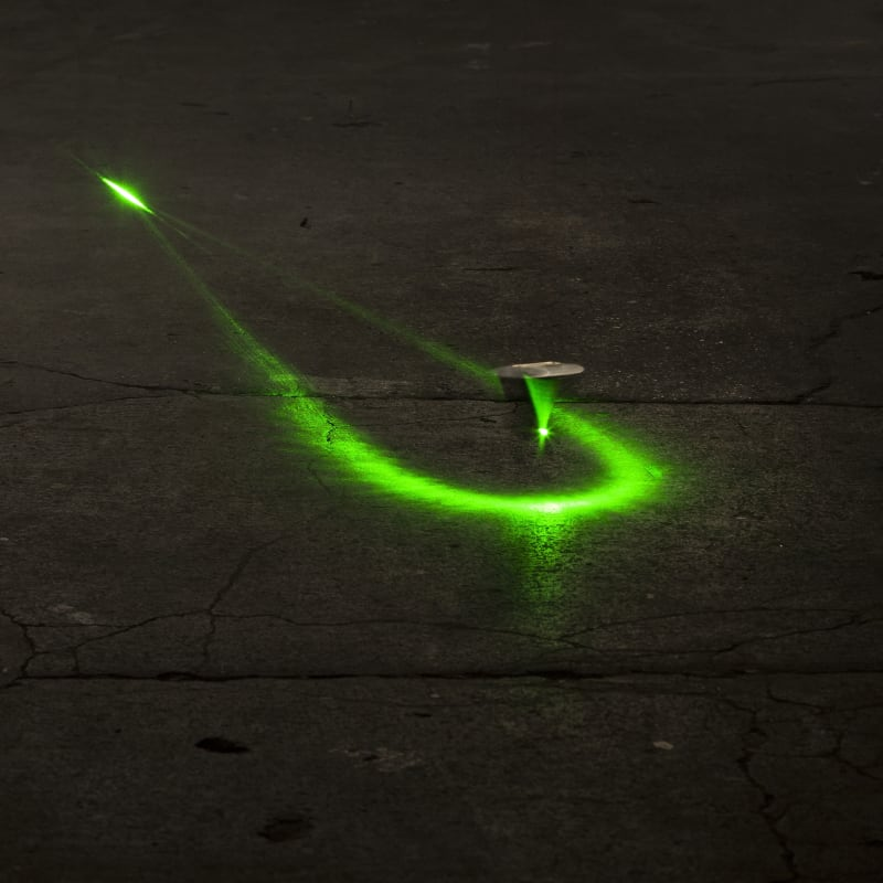 Green laser light and plumb-bob.  Studio view – Geneva, Switzerland.