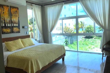 Very Private Ocean Side condo with Amazing Beach and Views.
