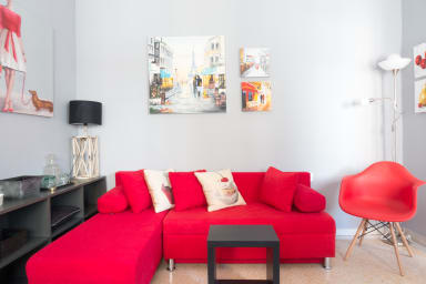 Big Red Sofa and some cute oil paintings on the walls