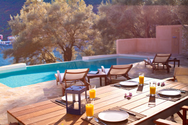 Outdoor dining table beside the swimming pool with excellent village view
