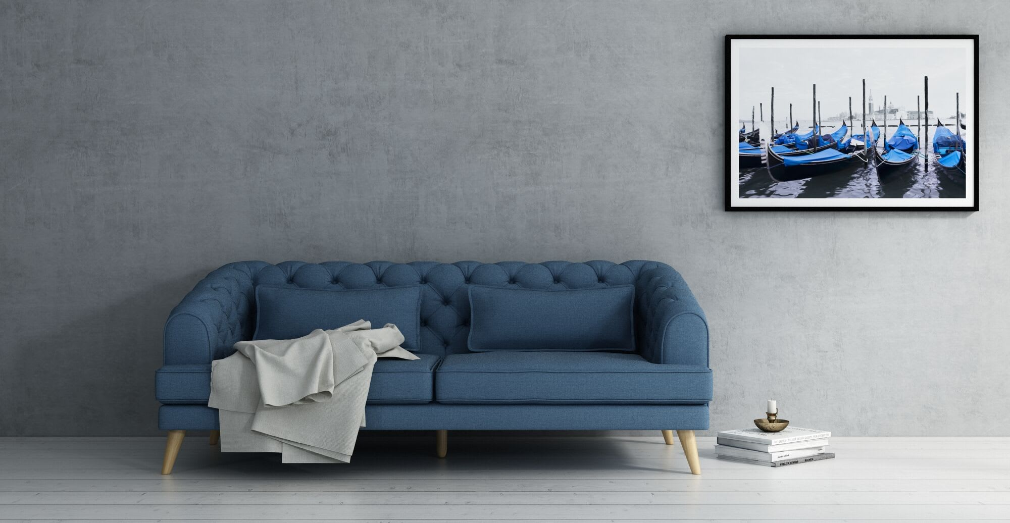 A navy sofa in a designed space