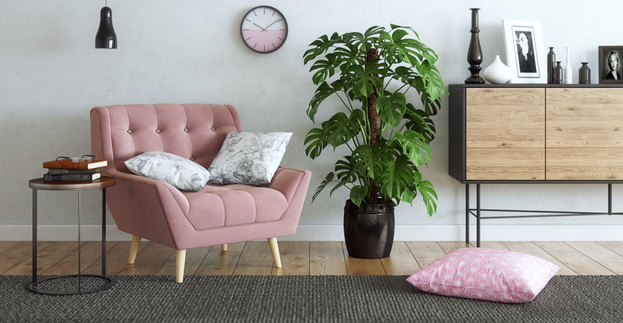 a designer pink chair with white throw pillows