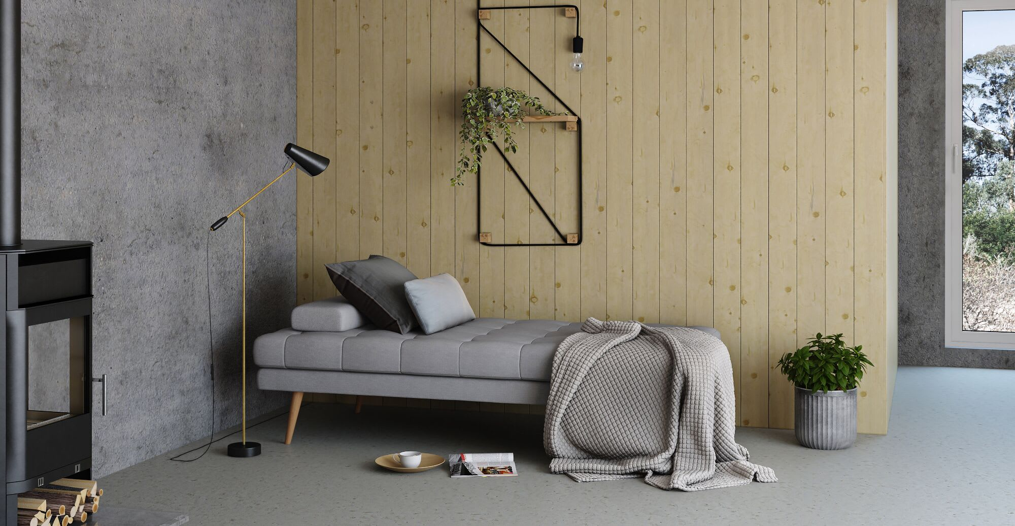 a grey sofa bed in a designed space