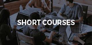 SHORT COURSES on background of students working on laptops
