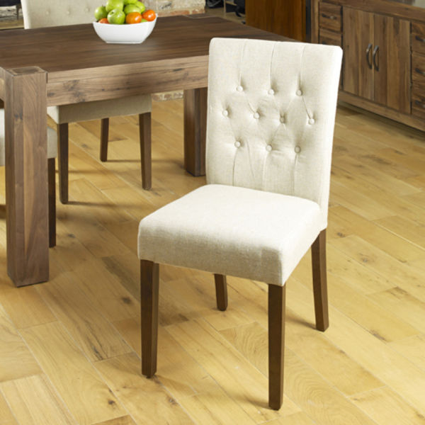 Two cream linen chairs