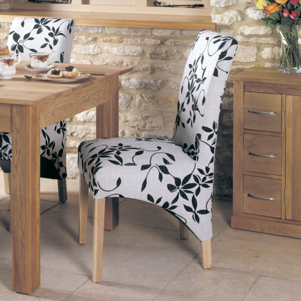 Two upholstered cream and brown flock dining chairs
