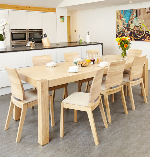 Olten Light Oak Six seat extending dining table with six cream chairs