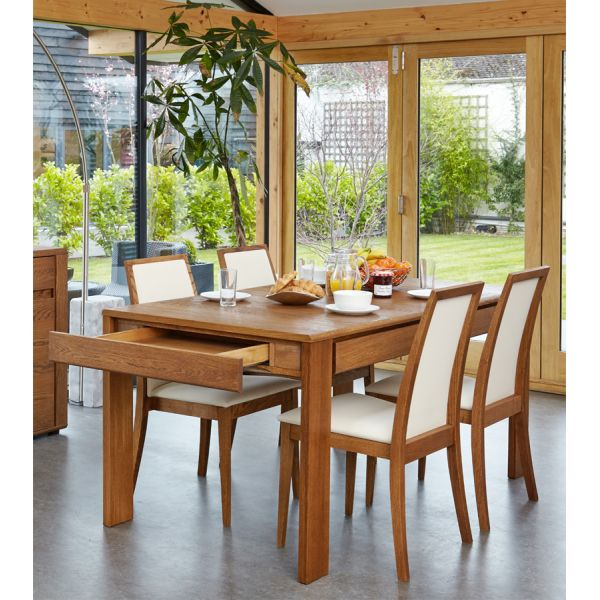 Olten Dark Oak Six/Eight seat extending table with drawer and eight cream chairs