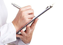 Holding a clipboard and ticking off quality marks