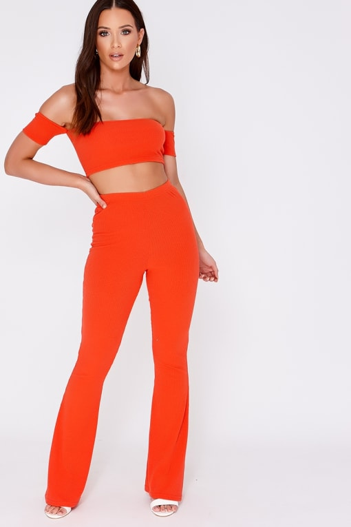 JAMIE LEE ORANGE RIBBED FLARE LEG TROUSERS