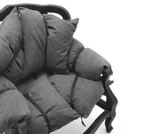 7 Pillows: Armchair with pillows upholstered in different materials