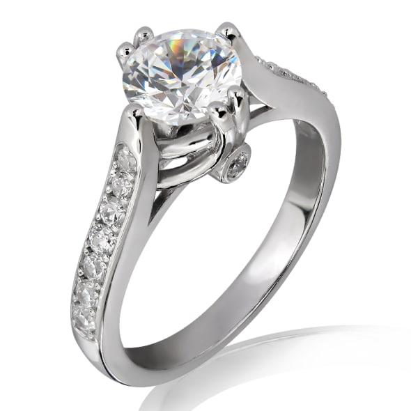 แหวนทอง 18K ประดับเพชร น้ำหนักรวม 0.70 กะรัต ค่าสี E ค่าความสะอาด VS