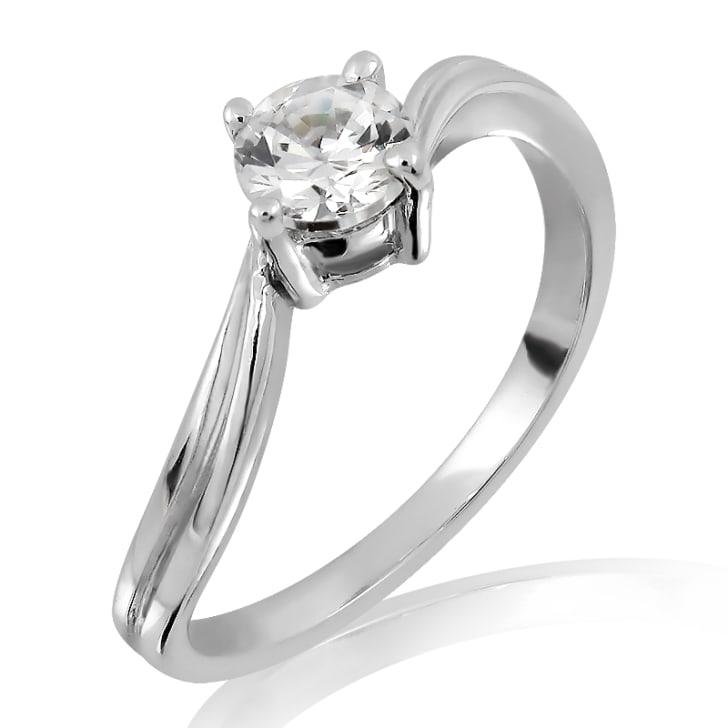 แหวนทอง 18K ประดับเพชร น้ำหนักรวม 0.30 กะรัต ค่าสี D ค่าความสะอาด VVS1 EX/EX/EX เพชรมาพร้อมใบรับรองจากสถาบัน GIA