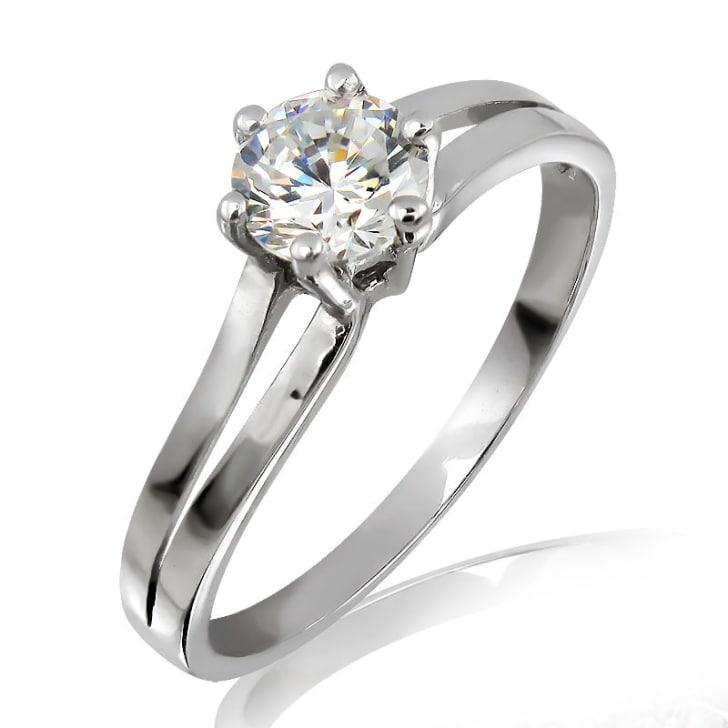 แหวนทอง 18K ประดับเพชร น้ำหนักรวม 0.30 กะรัต ค่าสี D ค่าความสะอาด VVS2 EX/EX/EX เพขรมาพร้อมใบรับรองจากสถาบัน GIA