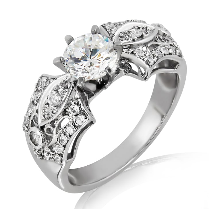 แหวนทอง 18K ประดับเพชร น้ำหนักรวม 1.38 กะรัต ค่าสี F ค่าความสะอาด VS2 EX/EX/EX เพชรมาพร้อมใบรับรองจาก GIA