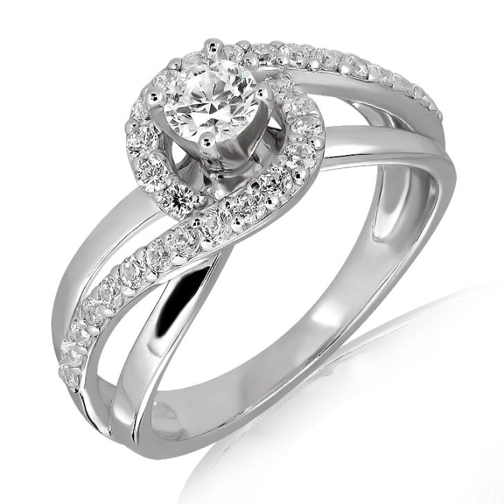 แหวนทอง 18K ประดับเพชร น้ำหนักรวม 0.70  กะรัต ค่าสี E  ค่าความสะอาด VS1