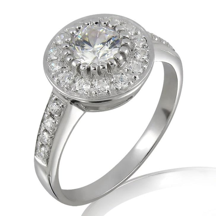 แหวนทอง 18K ประดับเพชร น้ำหนักรวม 0.85 กะรัต ค่าสี F ค่าความสะอาด VS2 เพชรมาพร้อมใบรับรองจาก GIA