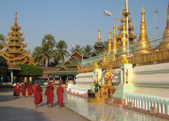 Buddhist monks walking around a Buddhist temple