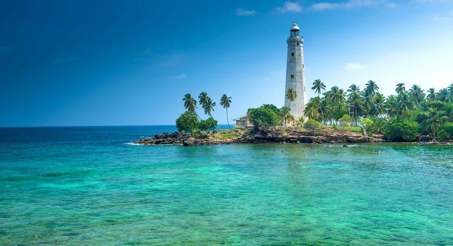 Leuchtturm an einem Strand von Sri Lanka