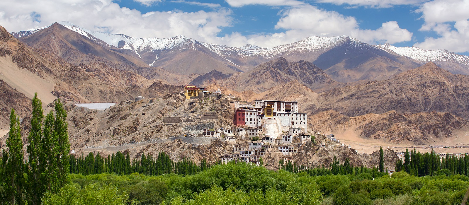 Enchanting Travels India Tours Leh Spituk Monastery with view of Himalayas mountains. Spituk Gompa is a famous Buddhist temple in Ladakh,