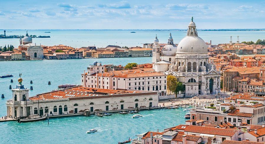 Enchanting Travels Italy Tours Panoramic aerial cityscape of Venice with Santa Maria della Salute church, Veneto, Italy