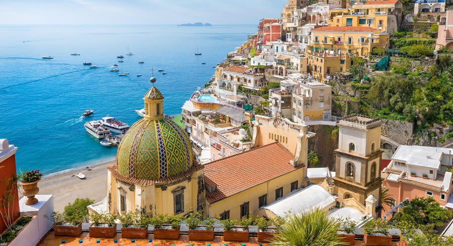 Enchanting Travels Italy Tours Beautiful Positano on hills leading down to coast