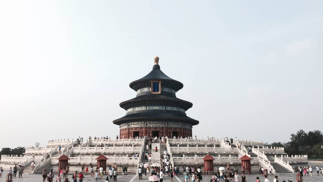a group of people standing in front of Temple of Heaven