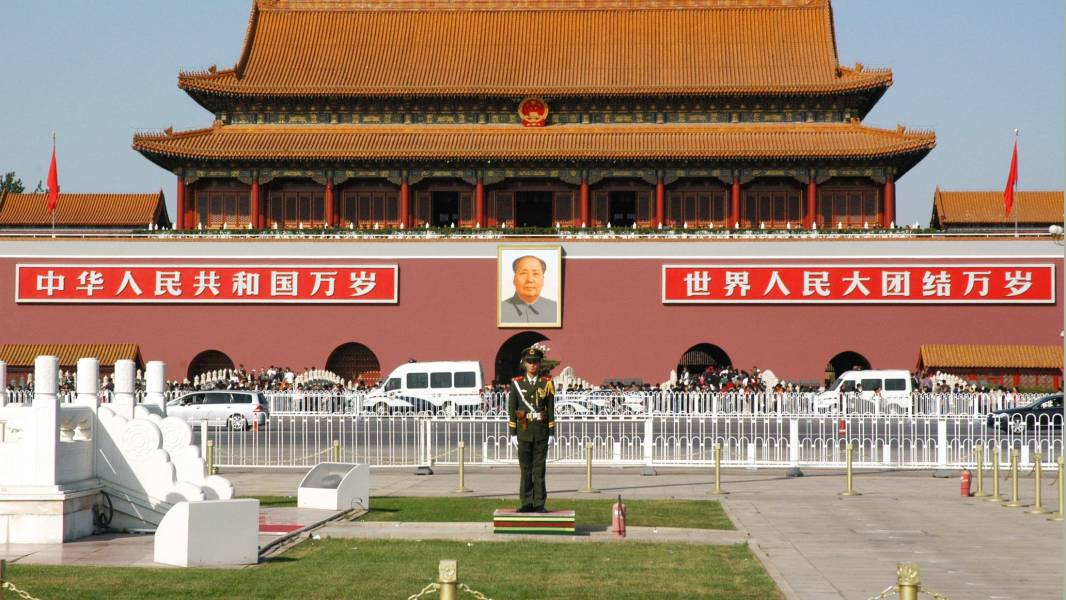 a group of people in front of Tiananmen Square