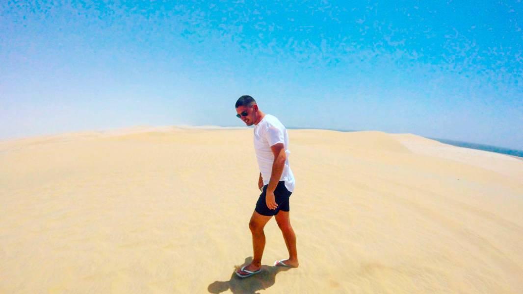 a man standing on a beach