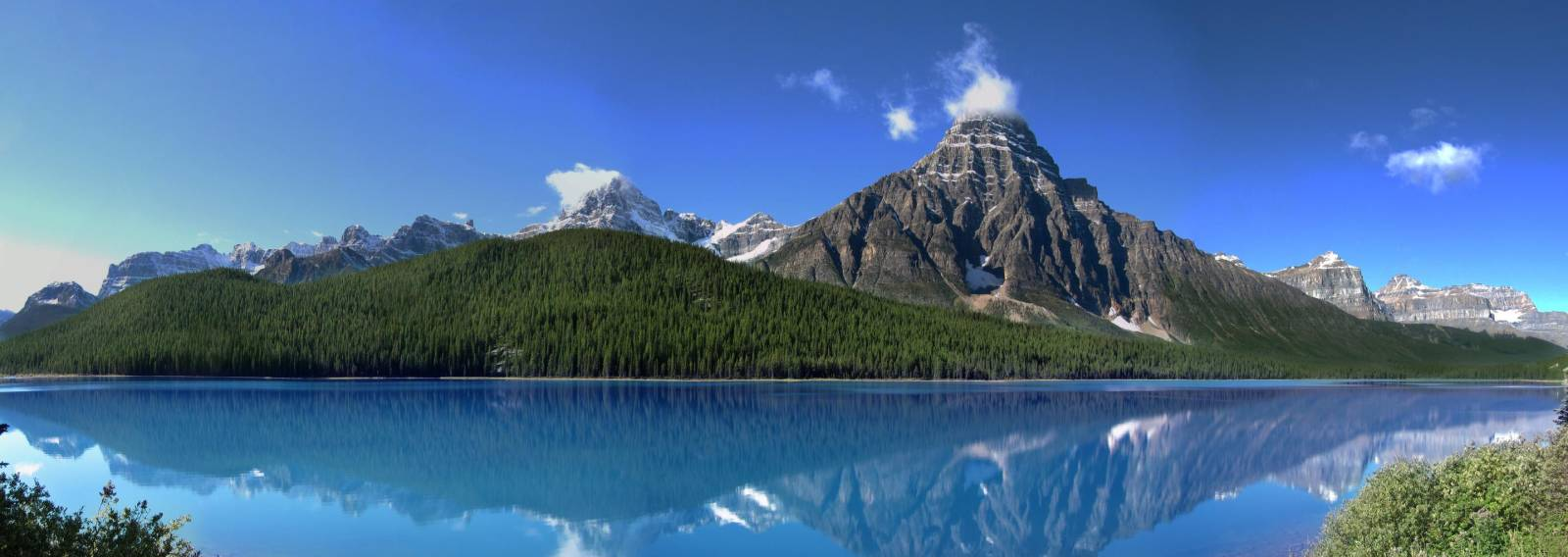 a lake with a mountain in the background
