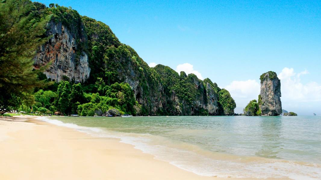 a body of water with Railay Beach in the background