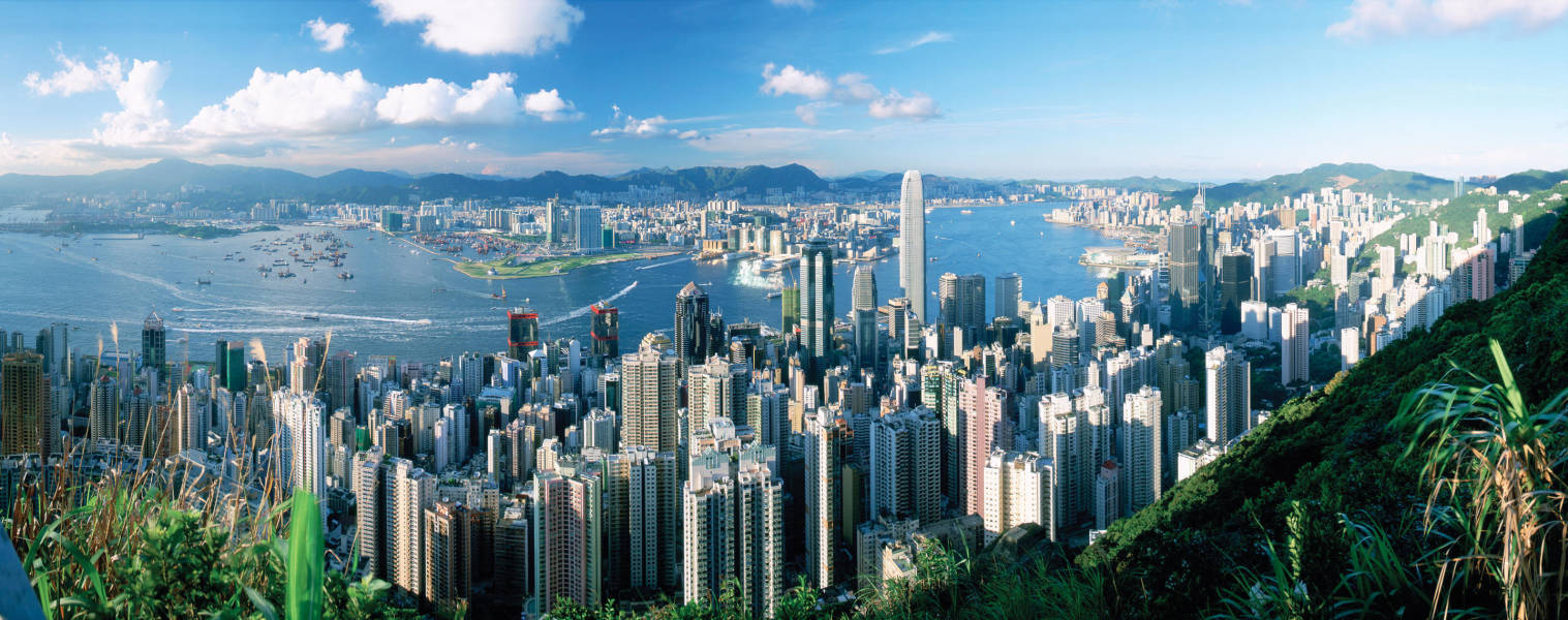 a view of Victoria Peak skyline with a mountain in the background