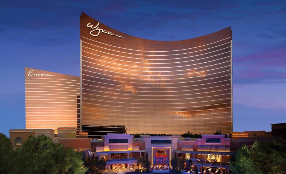 a large building in the background with Wynn Las Vegas in the background
