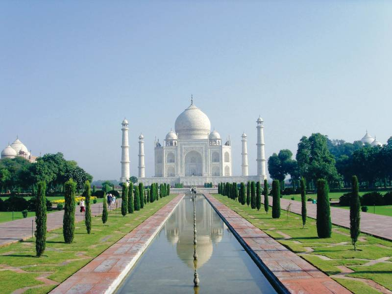 a large white building with Taj Mahal in the background