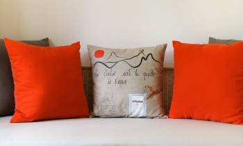 a red pillow on a bed
