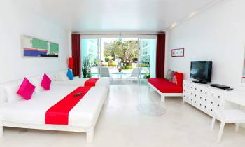 a living room with a red and white furniture