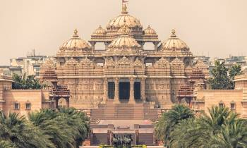a large building with Akshardham in the background