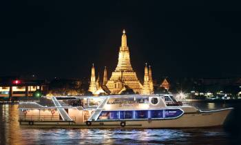 a boat that is lit up at night