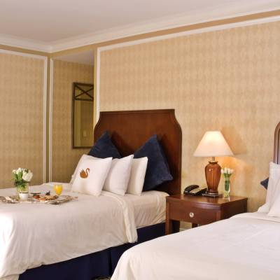 a large white bed in a hotel room