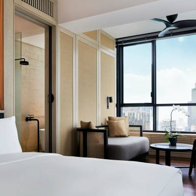 a hotel room with a large window