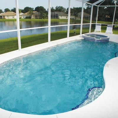 a pool next to a body of water