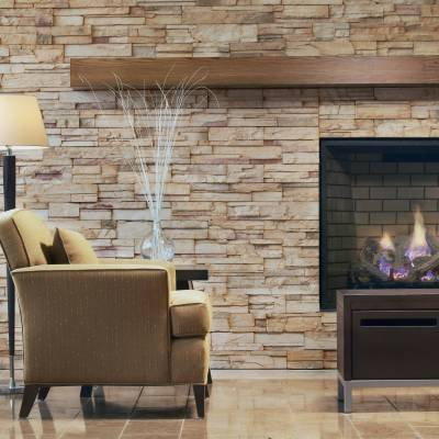 a fire place sitting in a living room with a stone fireplace