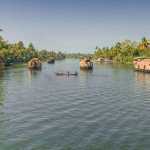 Couple of Houseboats in the backwaters at Alleppey in Kerala, India Asia