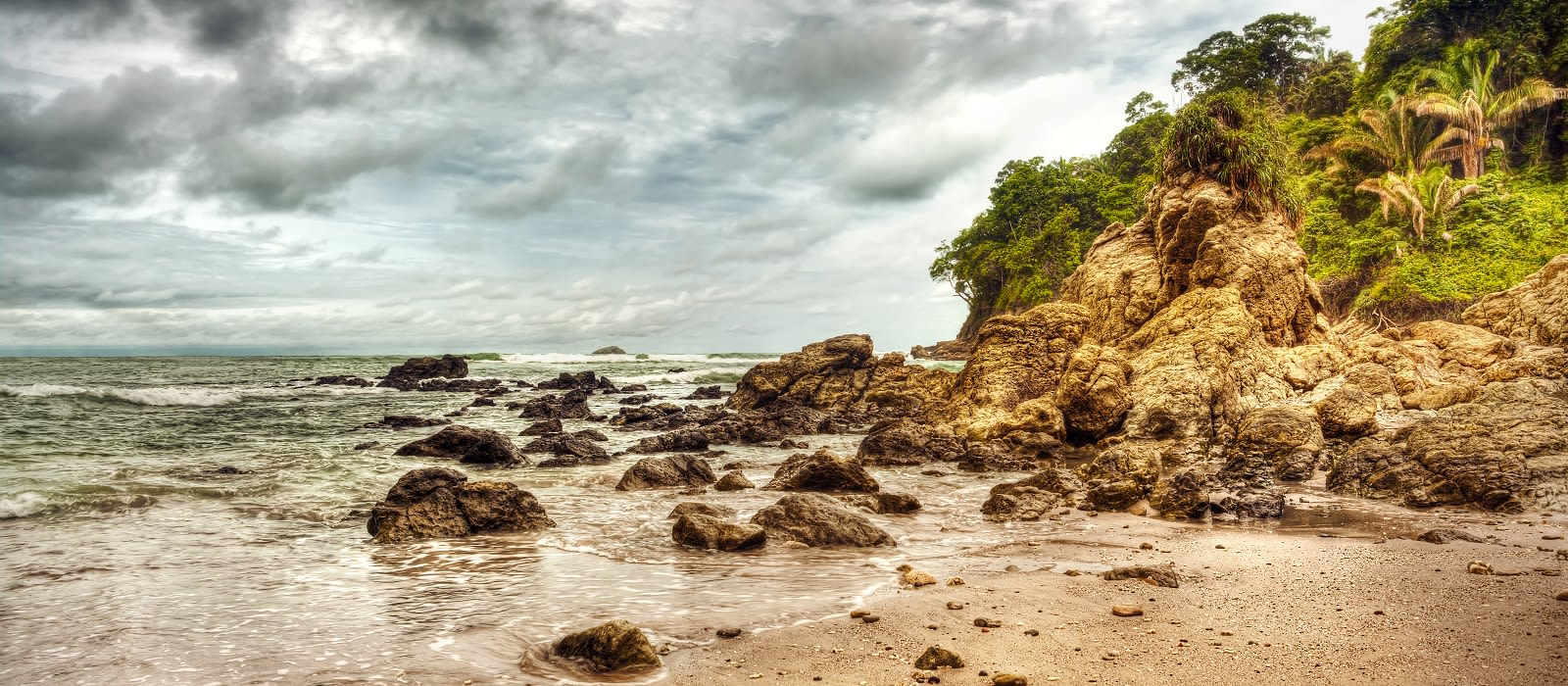 Enchanting Travels Dramatic storm on the beach of Costa Rica, Manuel Antonio national park