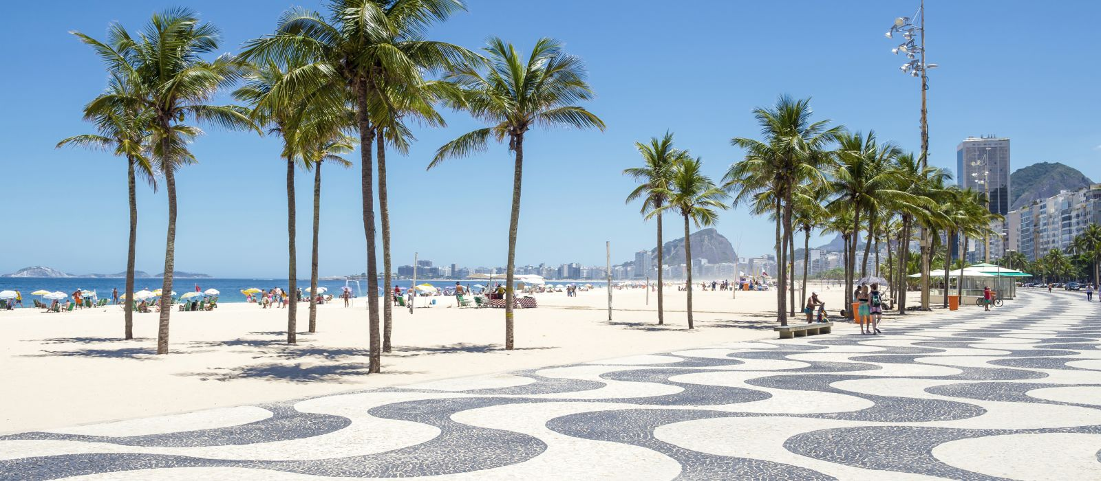 Bright scenic morning view of the iconic boardwalk at Copacabana Beach in Rio de Janeiro, Brazil, South America