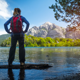 Woman hiker lake and mountains Bariloche, Argentina, South America