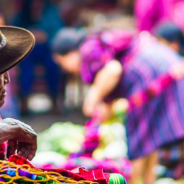 Enchanting Travels Guatemala Tours View on old maya man on market - packing for guatemala - best time to visit Guatemala