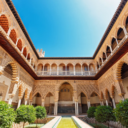 Things to do in Spain - Palace of Alcazar, Famous Andalusian Architecture. Old Arab Palace in Seville, Spain. Ornamented Arch and Column. Famous travel destination.