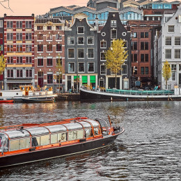 Enchanting Travels European Capitals ToursChannel in Amsterdam Netherlands houses river Amstel landmark old european city spring landscape.